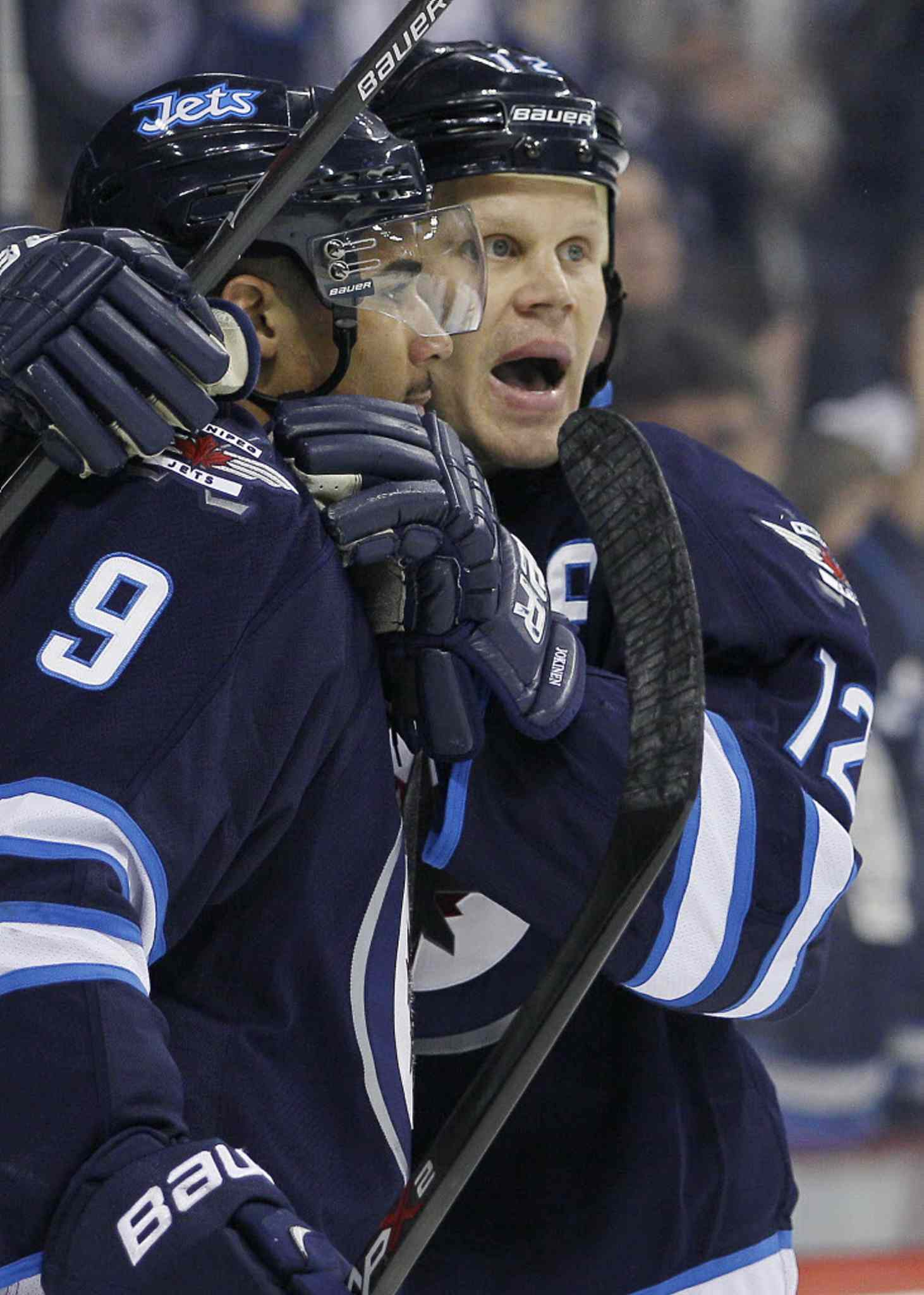 Winnipeg Jets' Olli Jokinen (12) and Evander Kane (9) celebrate Jokinen's goal during the second period on Thursday.