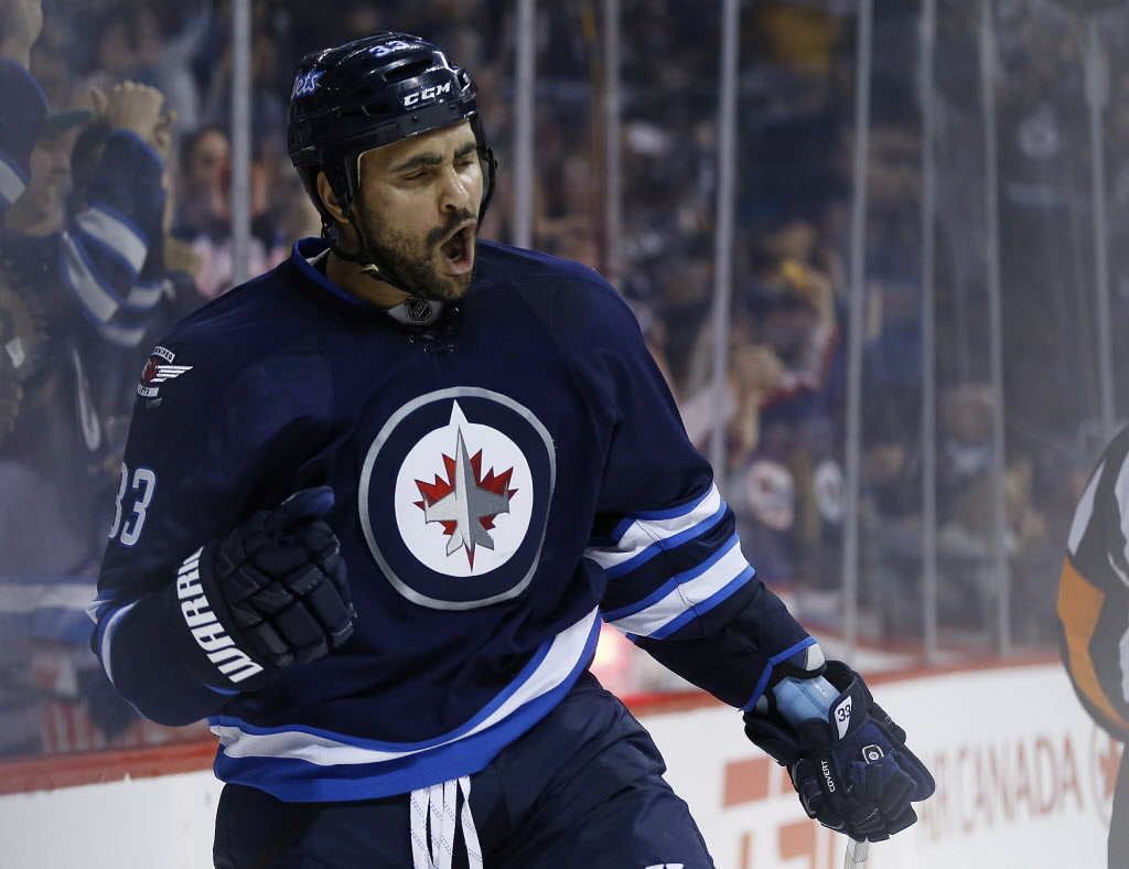Winnipeg Jets' Dustin Byfuglien (33) his goal against the Toronto Maple Leafs during the second period Saturday.  (John Woods / THE CANADIAN PRESS)