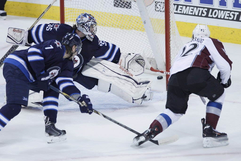 Colorado Avalanche's Gabriel Landeskog (92) rips the puck past Winnipeg Jets' goaltender Al Montoya for their second goal as Jets' Keaton Ellerby looks on during first period NHL action in Winnipeg on Wednesday, March 19, 2014.  (John Woods / THE CANADIAN PRESS)