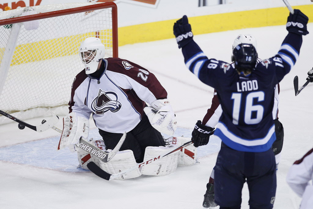 Winnipeg Jets' Andrew Ladd celebrates his goal against Colorado Avalanche goaltender Reto Berra (20) during third period NHL action.  (JOHN WOODS / THE CANADIAN PRESS )