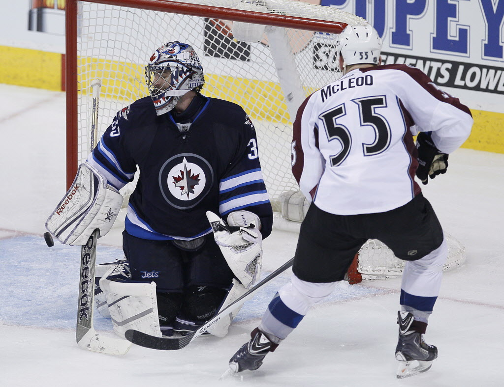 Colorado Avalanche's Cody McLeod (55) scores a goal against Winnipeg Jets goaltender Al Montoya to tie it up again during third period NHL action in Winnipeg.