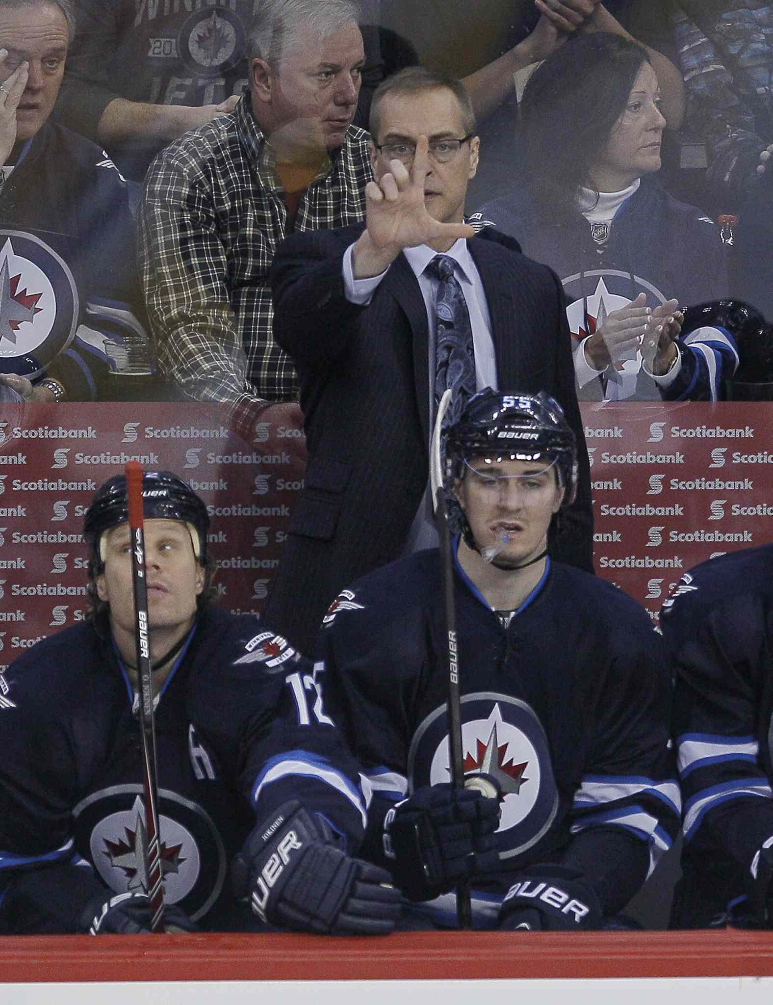 Winnipeg Jets head coach Paul Maurice signals to Michael Frolik (67) in the penalty box during first period NHL action against the Edmonton Oilers in Winnipeg on Saturday, January 18, 2014.