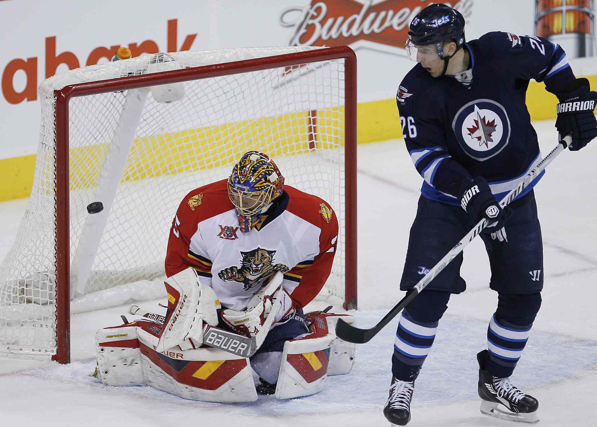 Winnipeg Jets' Blake Wheeler (26) deflects the shot from the point for the goal agaist Florida Panthers goaltender Jacob Markstrom during the first period.
