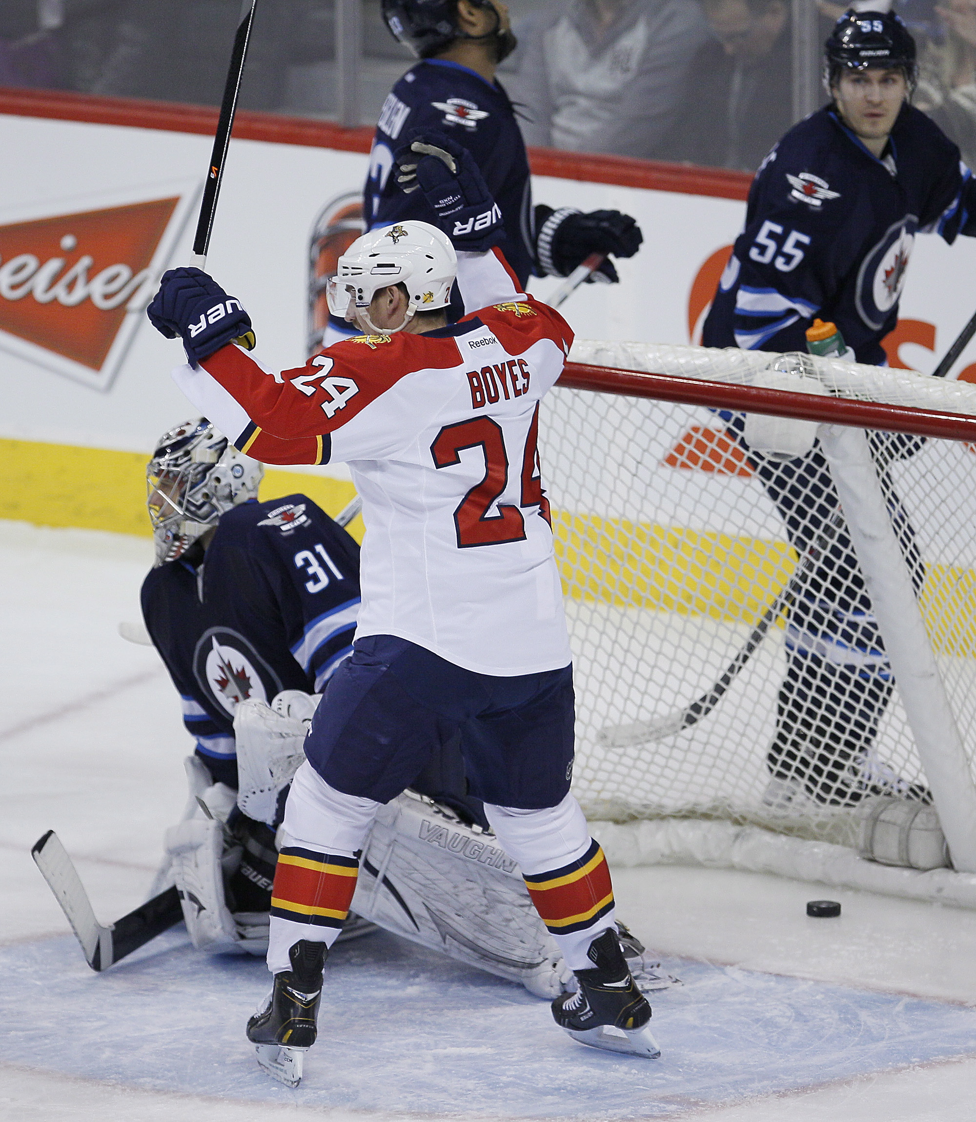 Florida Panthers' Brad Boyes (24) celebrates Shawn Matthias' (18) goal on Winnipeg Jets goaltender Ondrej Pavelec (31) as Jets' Dustin Byfuglien (33) and Mark Scheifele (55) skate by during the first period.