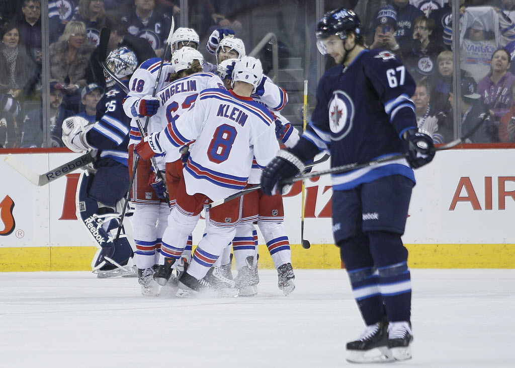 New York Rangers celebrate Carl Hagelin's (62) goal on Winnipeg Jets goaltender Al Montoya (35) and Michael Frolik (67) during second period NHL action.