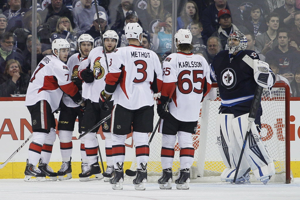 Ottawa Senators' Kyle Turris (7), Mike Hoffman (68), Bobby Ryan (6), Marc Methot (3) and Erik Karlsson (65) celebrate Turris' goal on Winnipeg Jets' goaltender Ondrej Pavelec (31) during second period NHL action in Winnipeg on Saturday, March 8, 2014.  (JOHN WOODS / The Canadian Press)