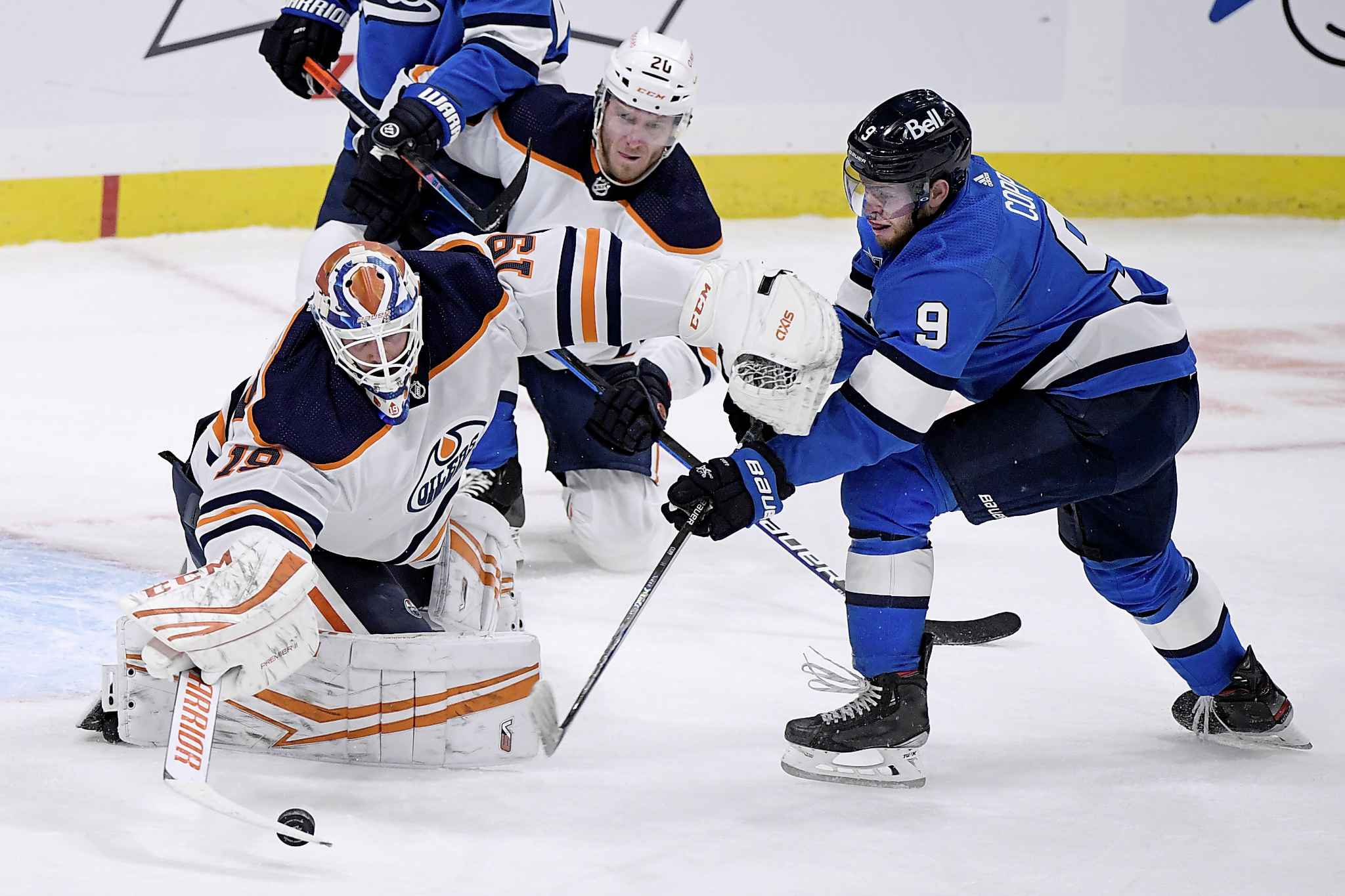 Edmonton Oilers goaltender Mikko Koskinen (19) makes a save on Winnipeg Jets' Andrew Copp (9) during the first period. (Fred Greenslade / The Canadian Press)
