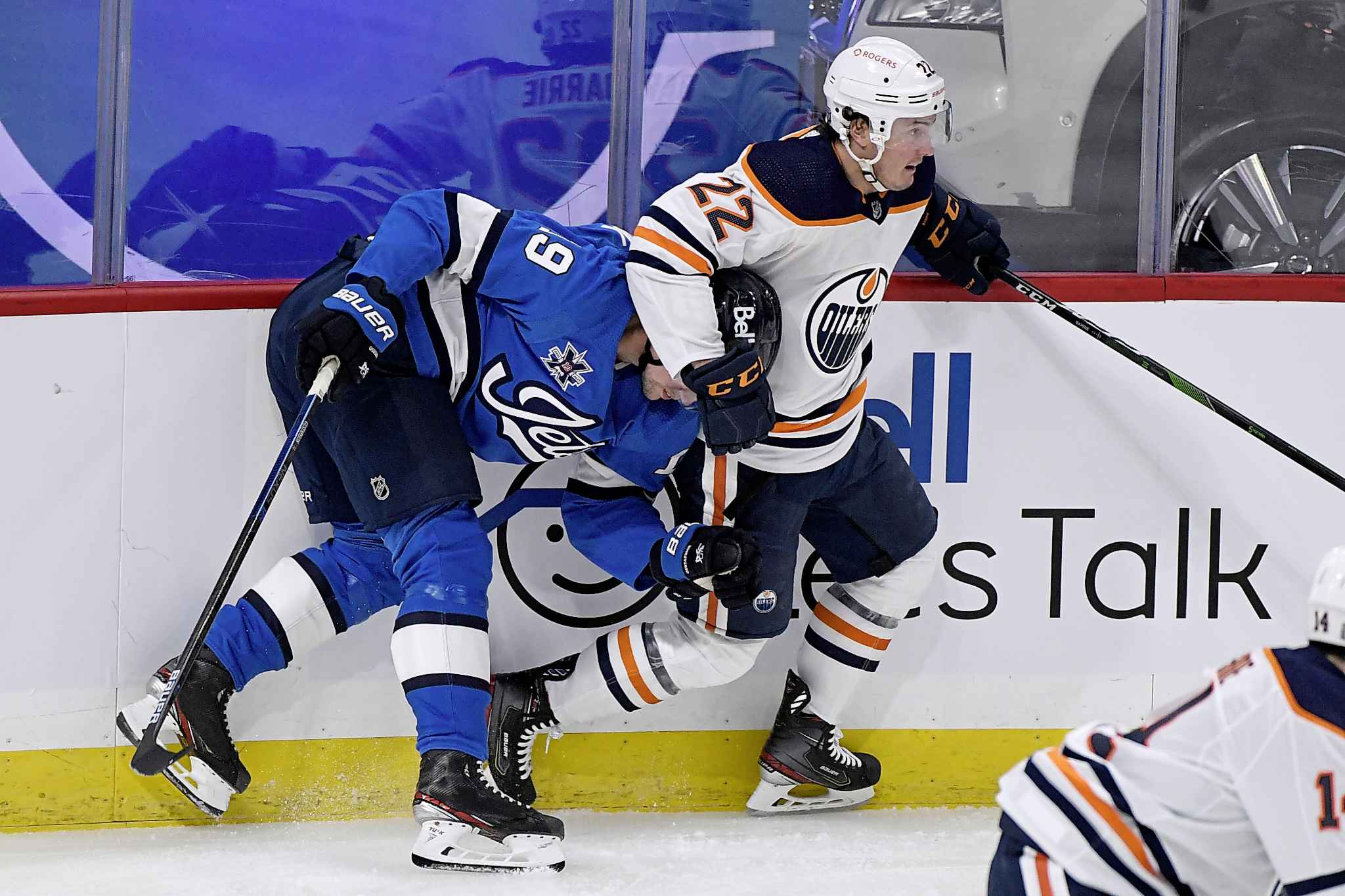 Winnipeg Jets' David Gustafsson (19) is checked by Edmonton Oilers' Tyson Barrie (22) during the first period. (Fred Greenslade / The Canadian Press)