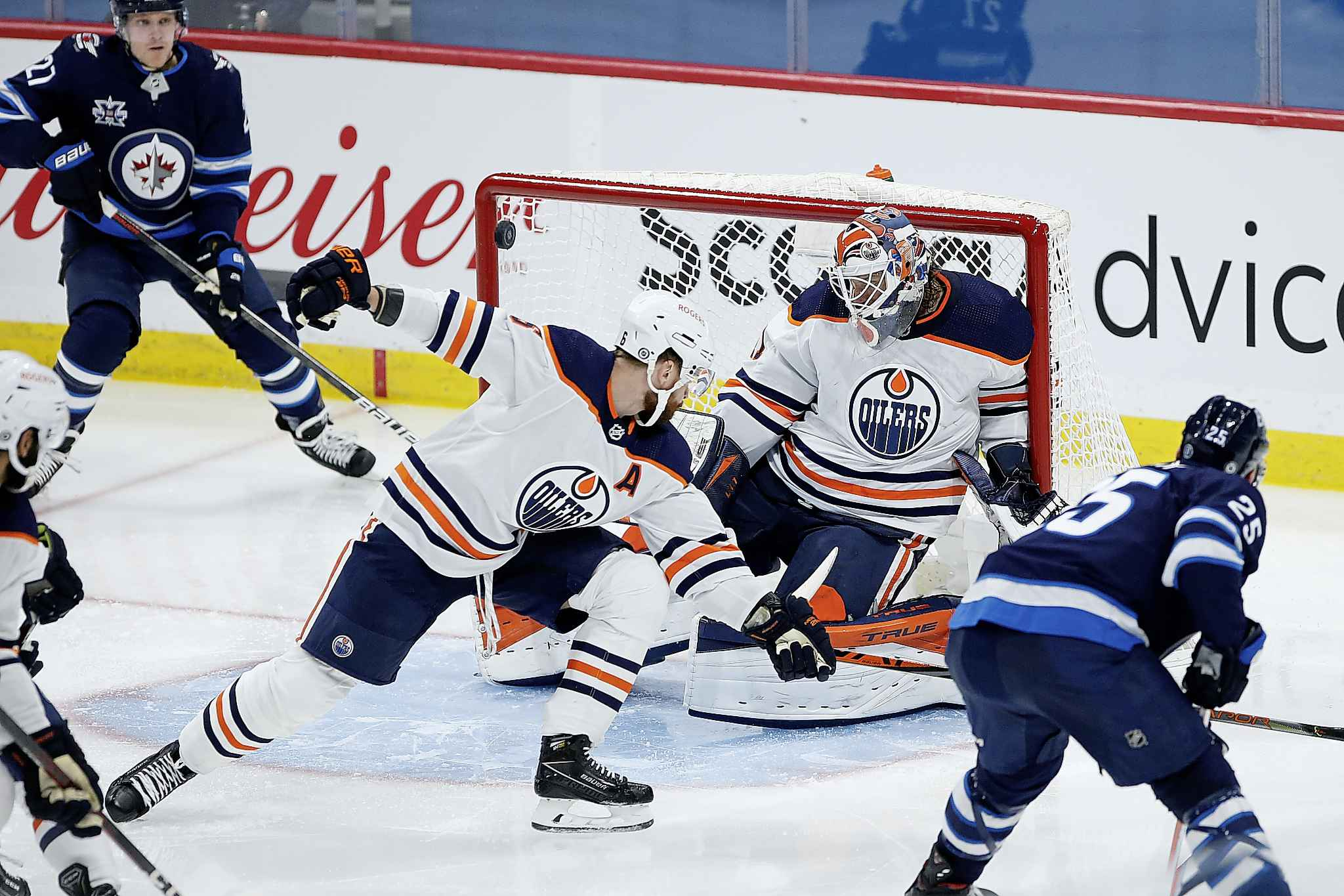 Edmonton Oilers goaltender Mike Smith (41) makes the save against Winnipeg Jets' Paul Stastny (25) as Adam Larsson (6) defends during the second period. (John Woods / The Canadian Press)