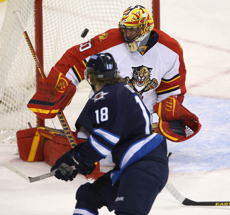 Florida Panthers goaltender Scott Clemmensen makes a shoulder save on Winnipeg Jets' Bryan Little (18) during first period NHL hockey action in Winnipeg, Tuesday, February 5, 2013. THE CANADIAN PRESS/Trevor Hagan