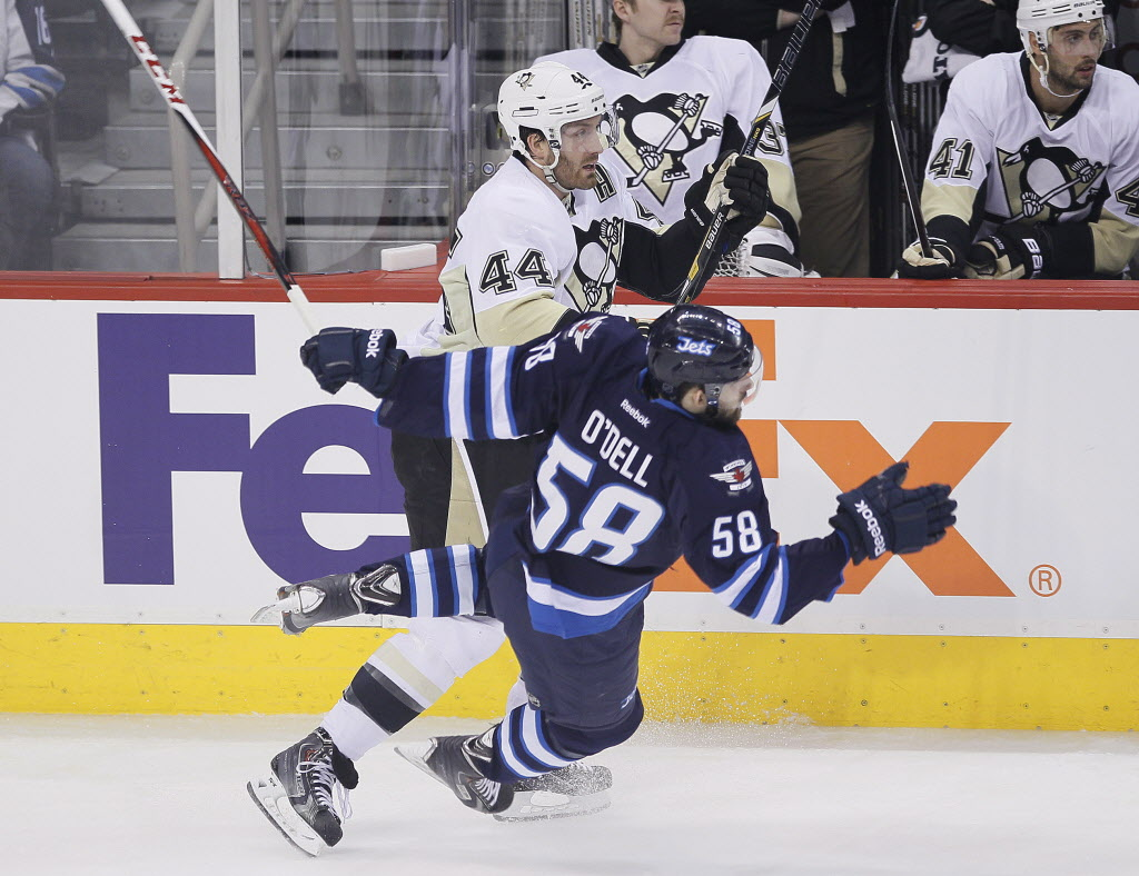 Pittsburgh Penguins' Brooks Orpik (44) checks Winnipeg Jets' Eric O'Dell (58) during first period NHL action in Winnipeg on Thursday.
