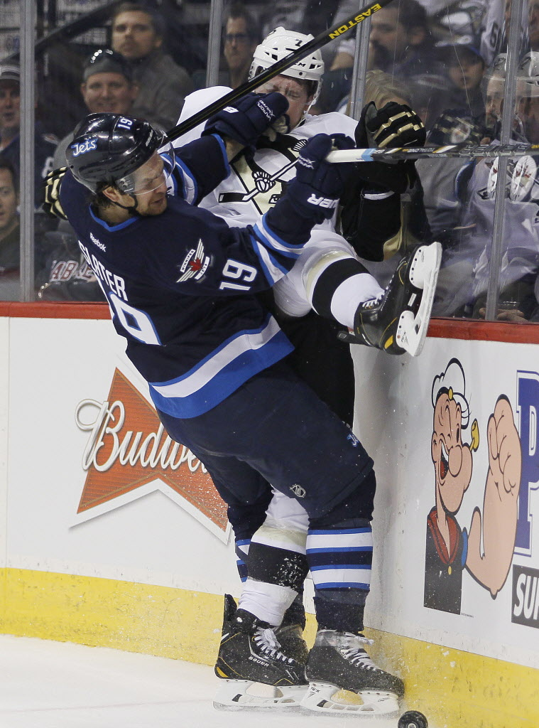 Winnipeg Jets' Jim Slater (19) checks Pittsburgh Penguins' Paul Martin (7) during the second period.