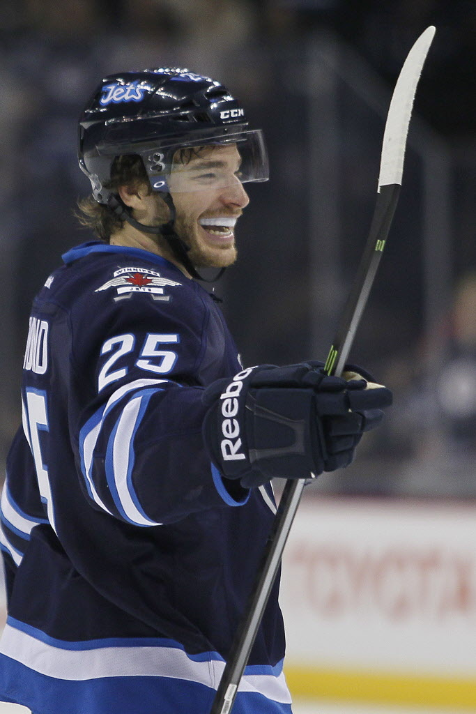 Winnipeg Jets' Zach Redmond (25) celebrates his goal against the Pittsburgh Penguins during the second period.