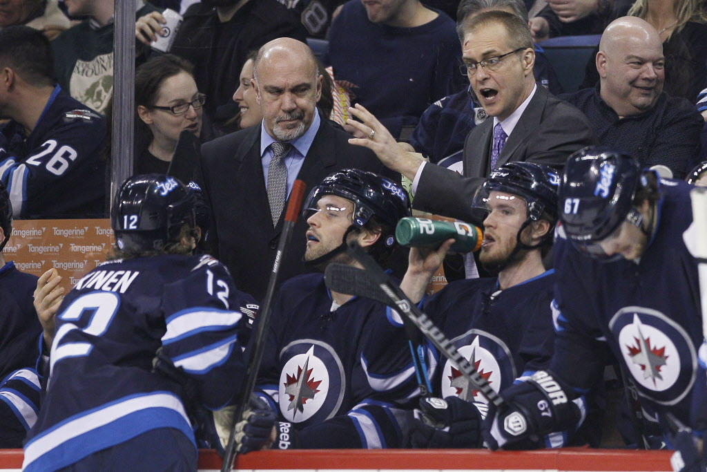 Winnipeg Jets' head coach Paul Maurice talks to Olli Jokinen (12) during a break in the second period.