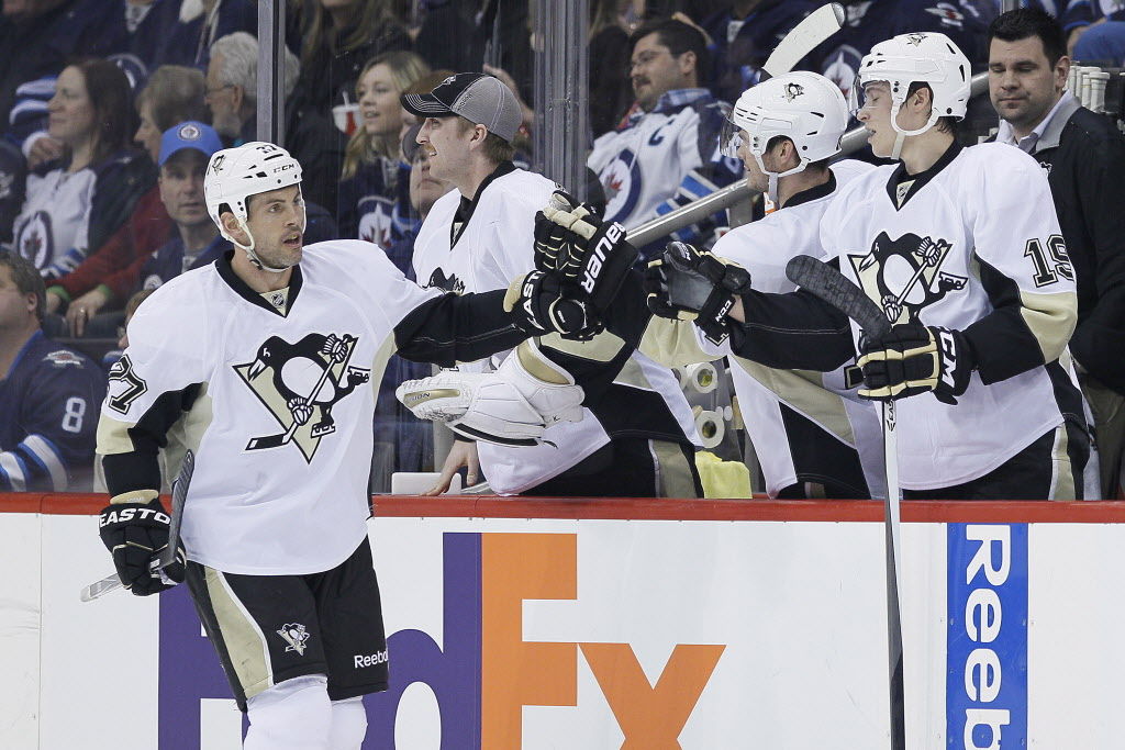 Pittsburgh Penguins' Craig Adams (27) celebrates his goal against the Winnipeg Jets during second period NHL action.