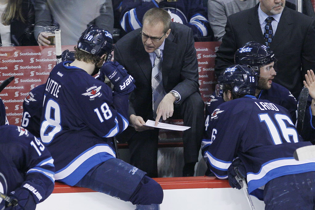Winnipeg Jets head coach Paul Maurice talks with Bryan Little (18). (JOHN WOODS / THE CANADIAN PRESS)