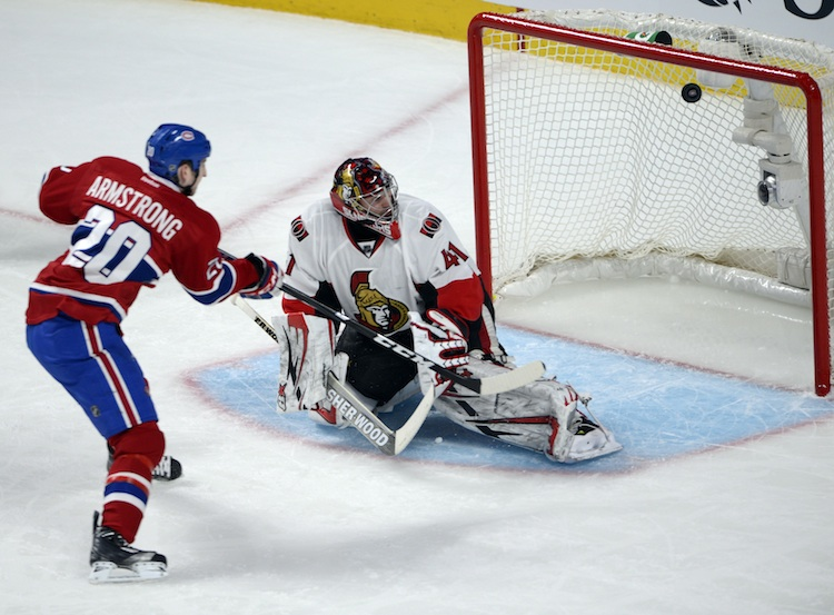 Montreal Canadiens right wing Colby Armstrong hits the crossbar as Ottawa Senators goalie Craig Anderson looks on during the second period. (Ryan Remiorz / The Canadian Press)