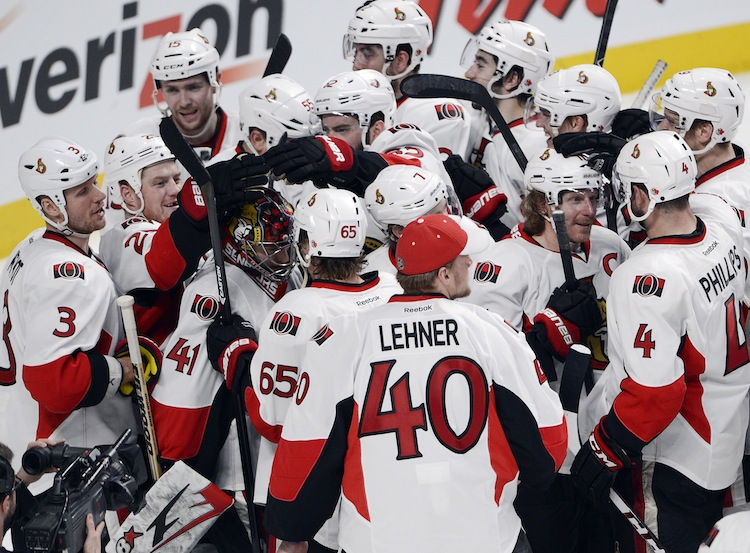 Ottawa Senators celebrate after the final buzzer. The Sens defeated the Montreal Canadiens 6-1 in game five, winning the series four games to one. (Ryan Remiorz / The Canadian Press)
