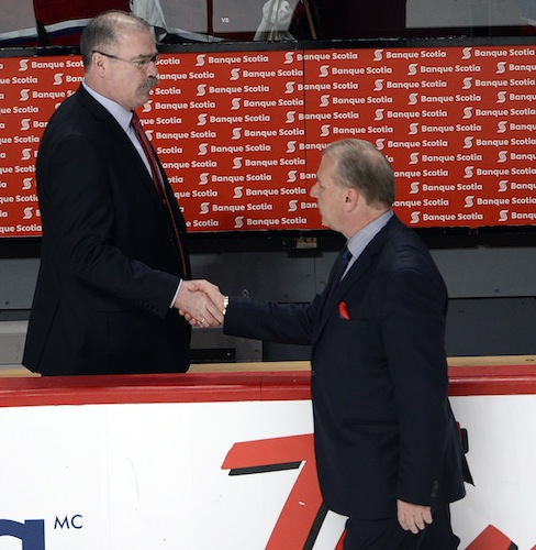 Ottawa Senators head coach Paul MacLean, left, shakes hands with Montreal Canadiens head coach Michel Therrien after the Senators eliminated the Canadiens. (CP)