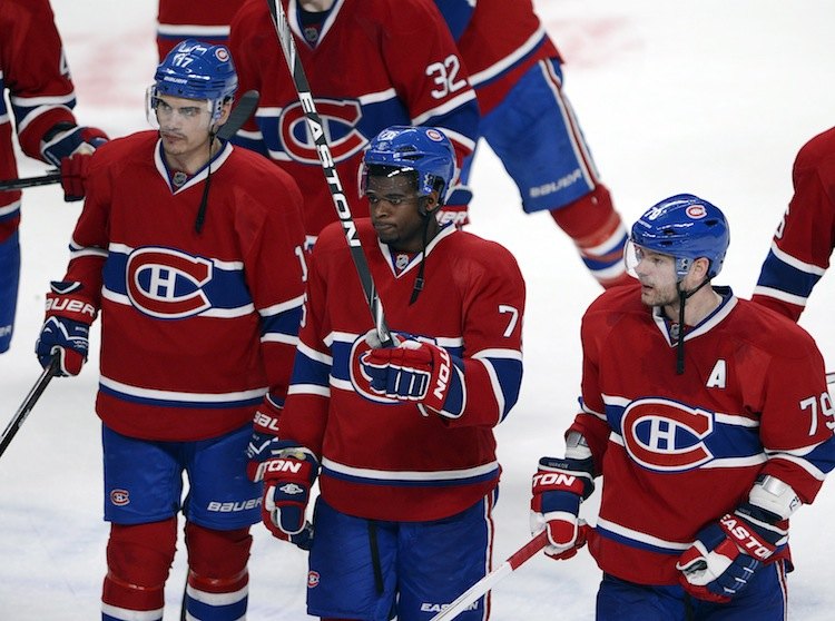 Montreal Canadiens Rene Bourque (left), P.K. Subban (center) and Andrei Markov (right) salute the crowd in Montreal after being eliminated by the Ottawa Senators 6-1 Thursday night.