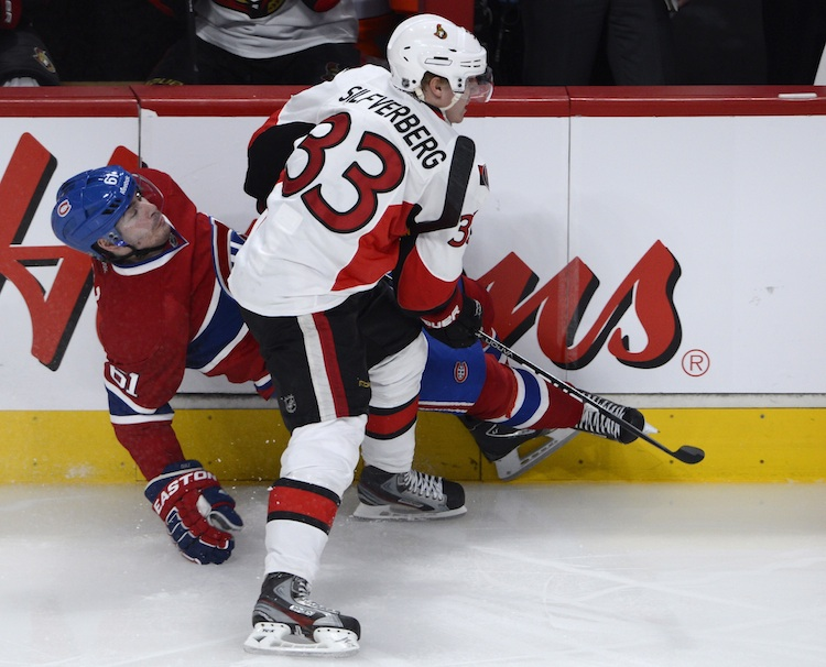 Ottawa Senators' Jakob Silfverberg picks up an interference penalty as he rubs out Montreal Canadiens' Raphael Diaz during the second period.
