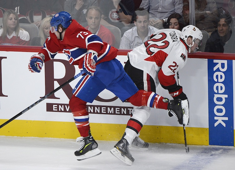 Montreal Canadiens' Michael Ryder collides with Ottawa Senators' Erik Condra during the first period.  (Graham Hughes / The Canadian Press)