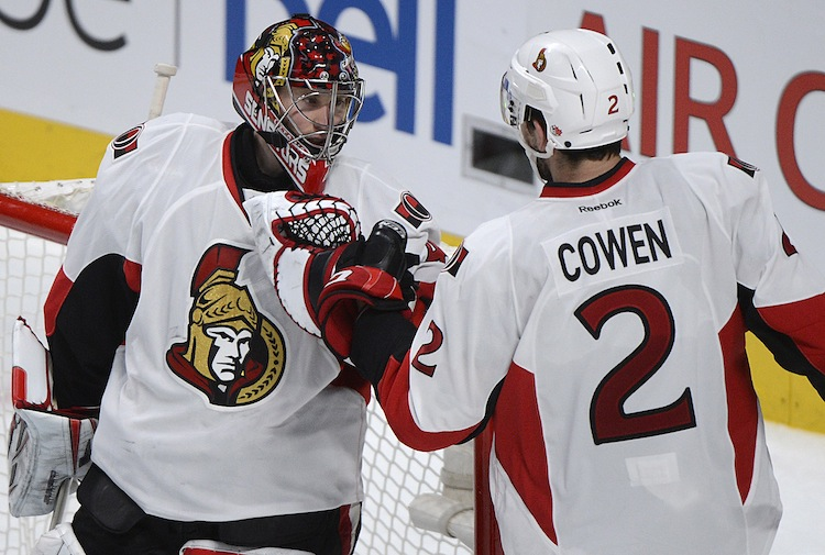 Ottawa Senators' goaltender Craig Anderson celebrates with teammate Jared Cowen after the final buzzer sounded to clinch the game.