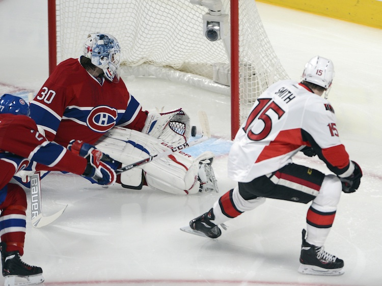 Ottawa Senators' Zach Smith opens the scoring, putting the puck past Montreal Canadiens goalie Peter Budaj during the first period of Thursday night's game.  (Ryan Remiorz / The Canadian Press)