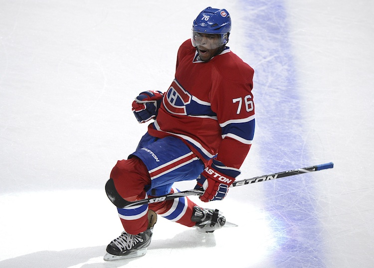 Montreal Canadiens' P.K. Subban celebrates after scoring in the dying seconds of the first period on the power play, sending the teams to their respective dressing rooms with the Senators leading 2-1. (Graham Hughes / The Canadian Press)