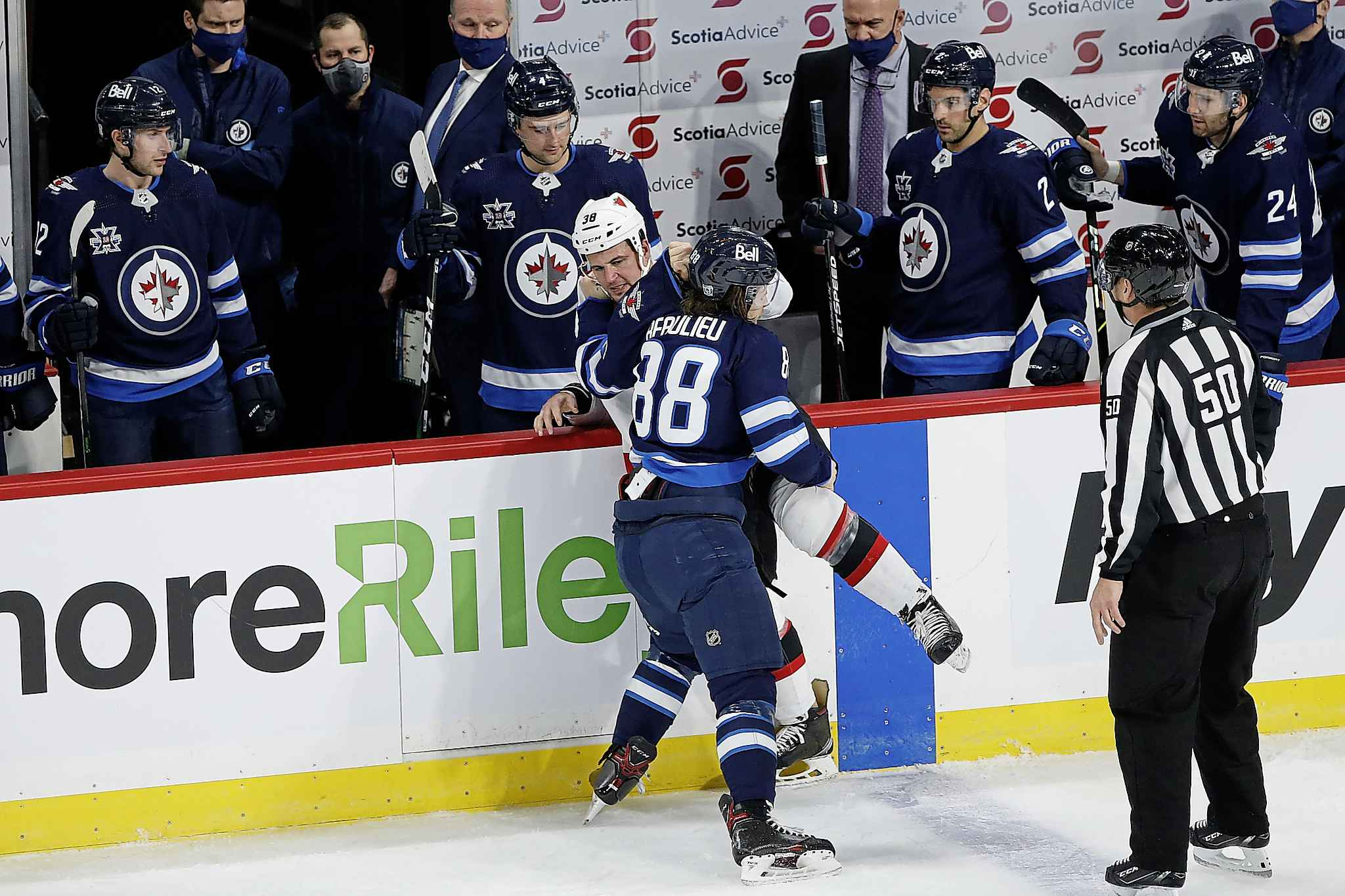 Winnipeg Jets' Nathan Beaulieu (88) tries to throw Ottawa Senators' Micheal Haley (38) over the boards during first period NHL action in Winnipeg on Saturday, January 23, 2021. (John Woods / The Canadian Press)
