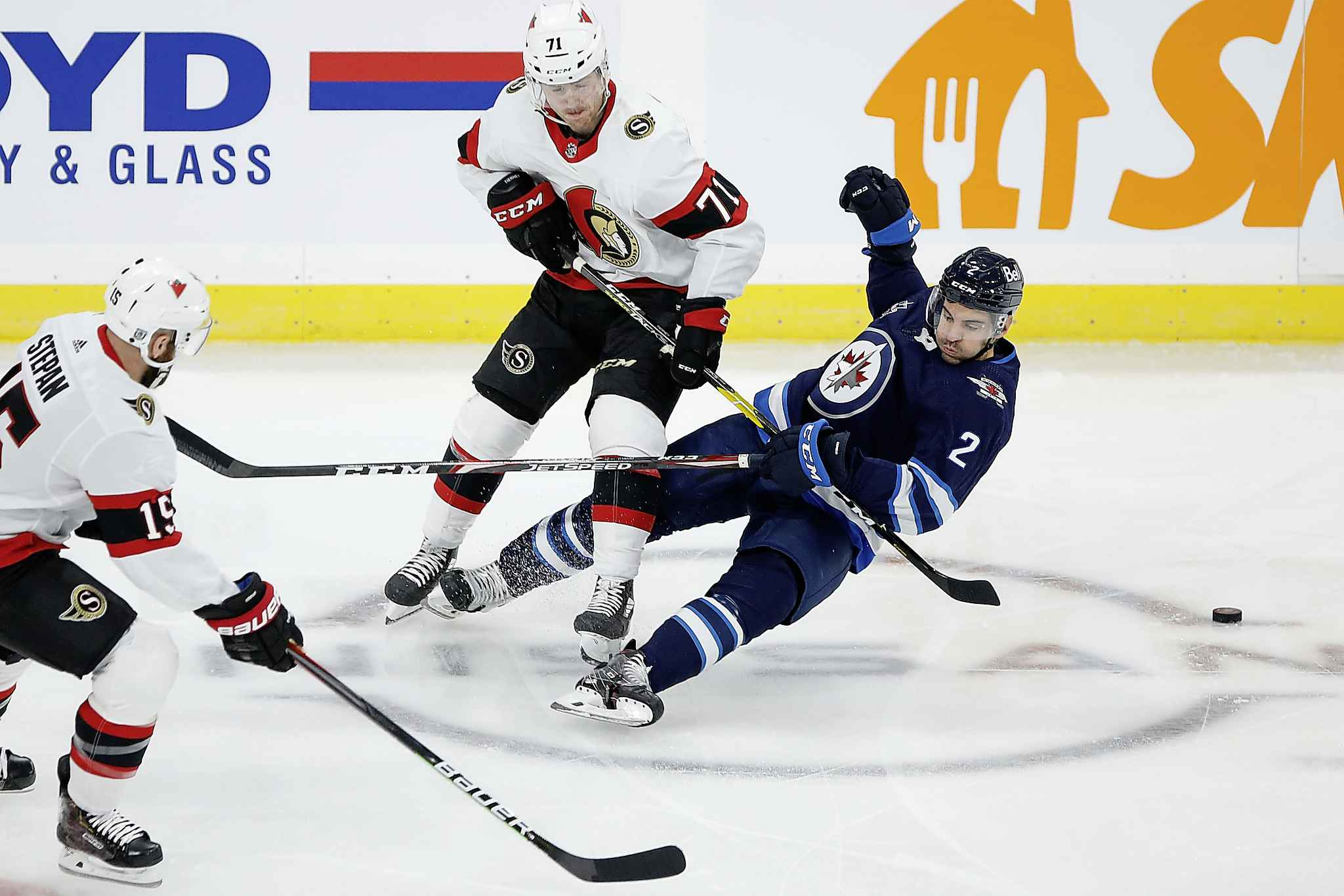 Winnipeg Jets' Dylan DeMelo (2) and Ottawa Senators' Chris Tierney (71) collide during first period NHL action in Winnipeg on Saturday, January 23, 2021. (John Woods / The Canadian Press)
