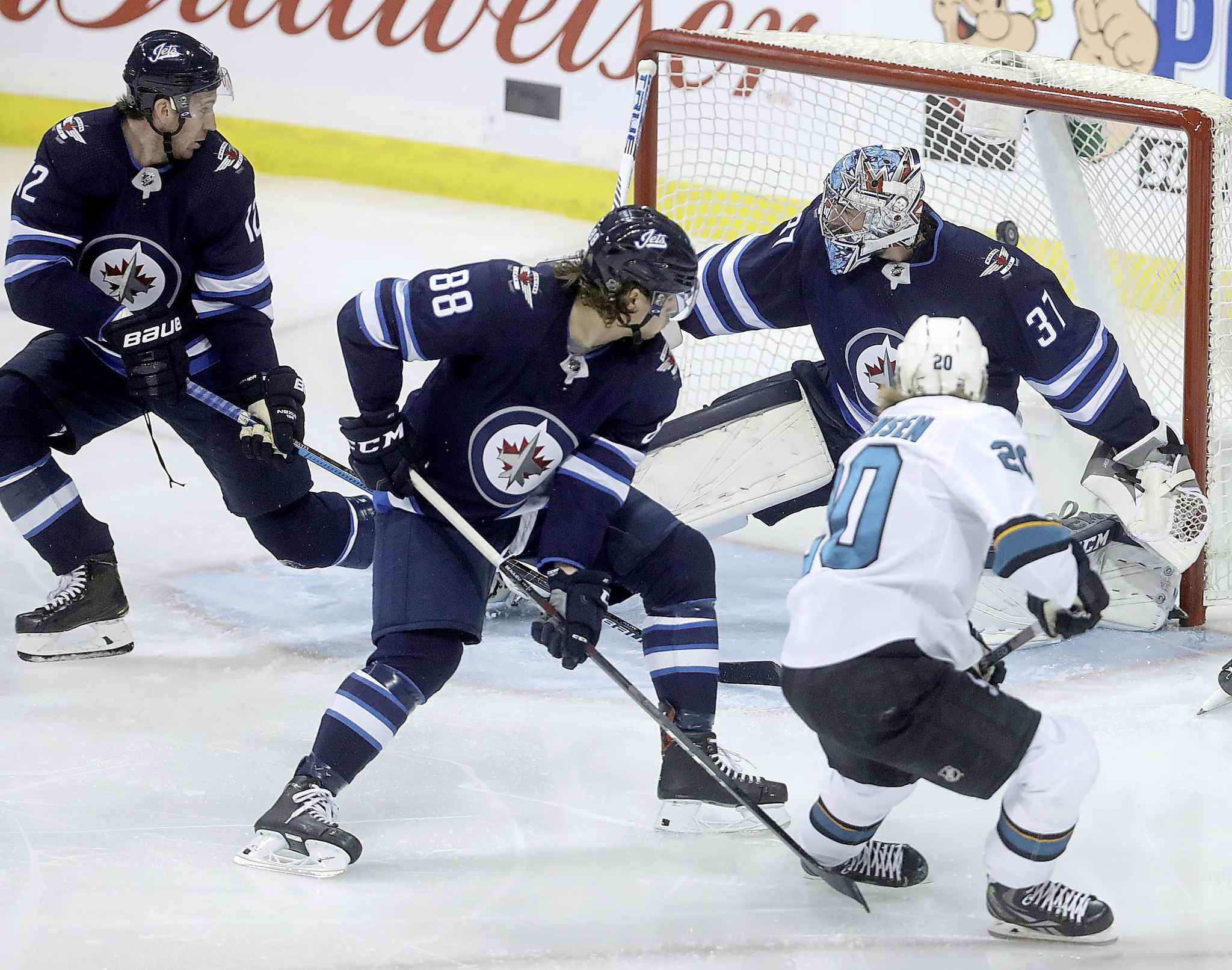 San Jose Sharks' Marcus Sorenson (20) scores on Connor Hellebuyck with four seconds left in the game.