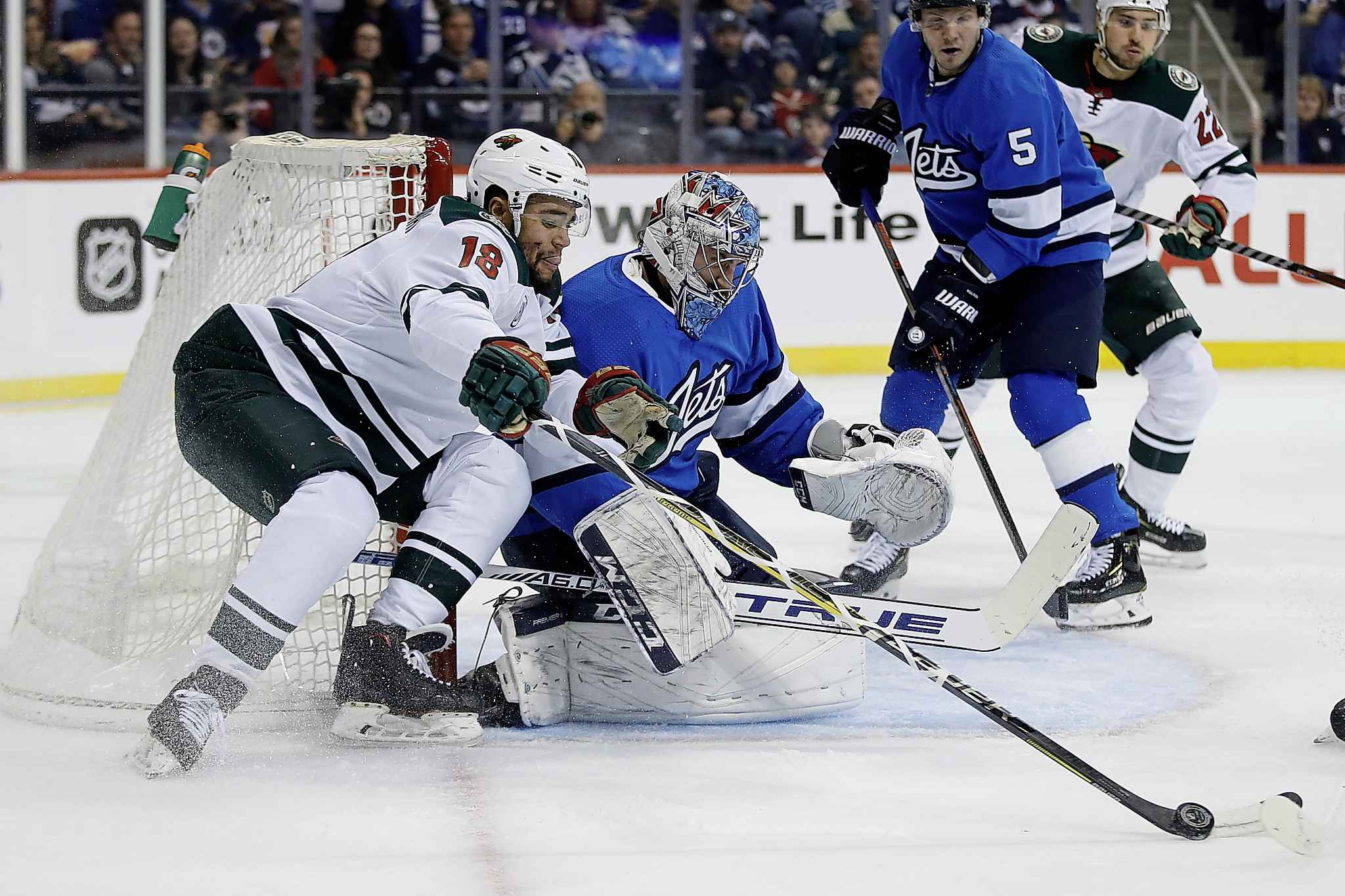 JOHN WOODS / THE CANADIAN PRESS</p><p>Minnesota Wild's Jordan Greenway (18) tries to recover the rebound off his shot on Winnipeg Jets goaltender Connor Hellebuyck (37) during first period NHL action in Winnipeg on Saturday, December 29, 2018.</p>