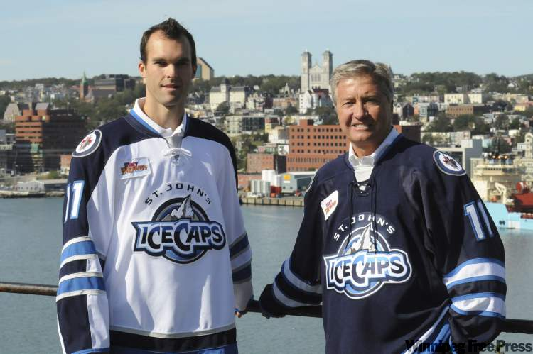 IceCaps president Danny Williams (right) and right-winger Jason King debut the team's jerseys.