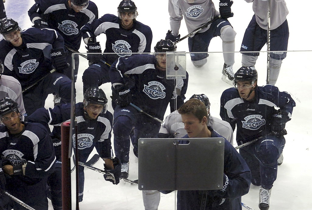 St. John's IceCaps head coach Keith McCambridge uses a white board to map out plays for his players in St. John's in 2011 on the first day of training camp for the AHL team.