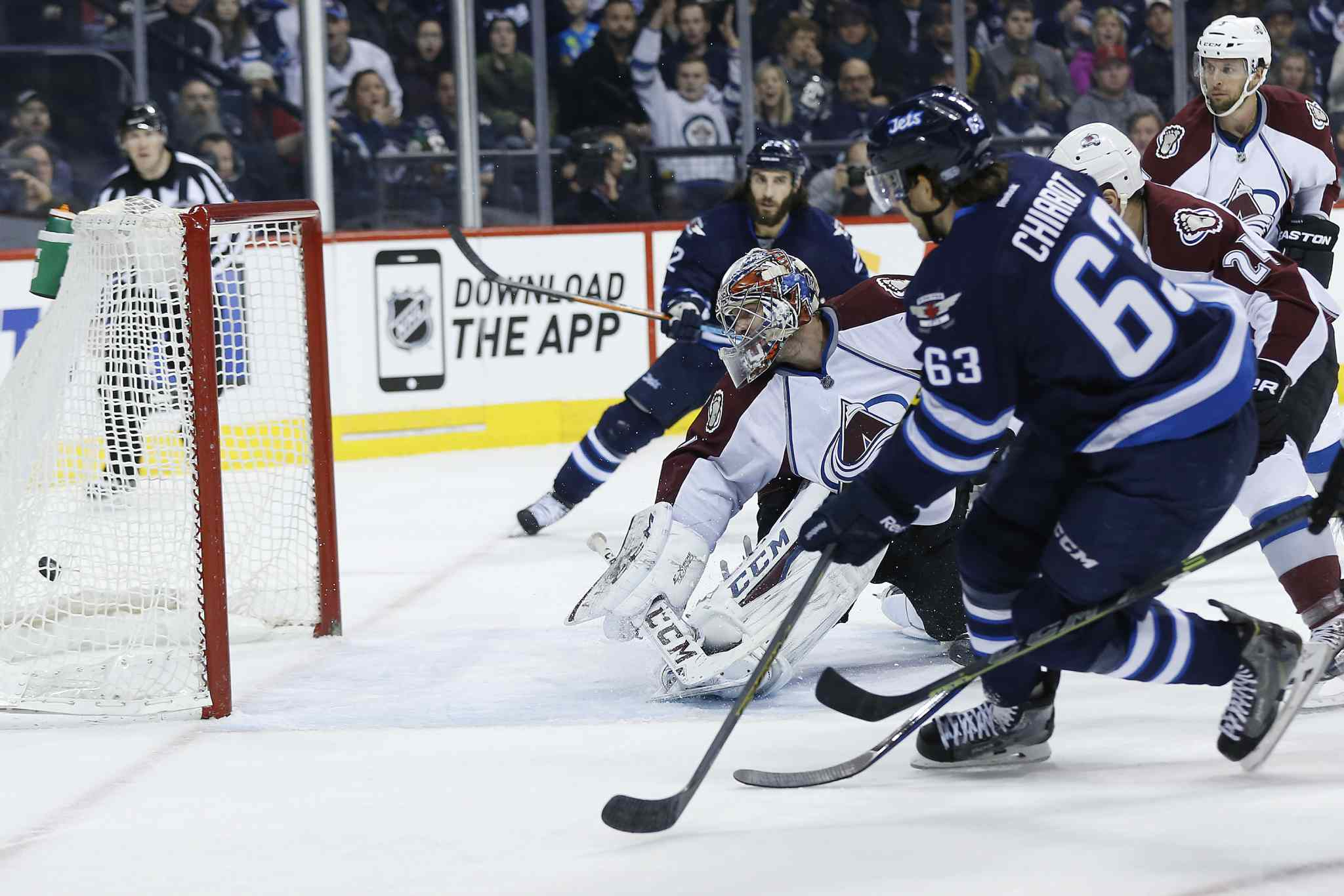 Winnipeg Jets defenceman Ben Chiarot (63) drives the puck past Colorado Avalanche goaltender Semyon Varlamov during second-period action Sunday night.