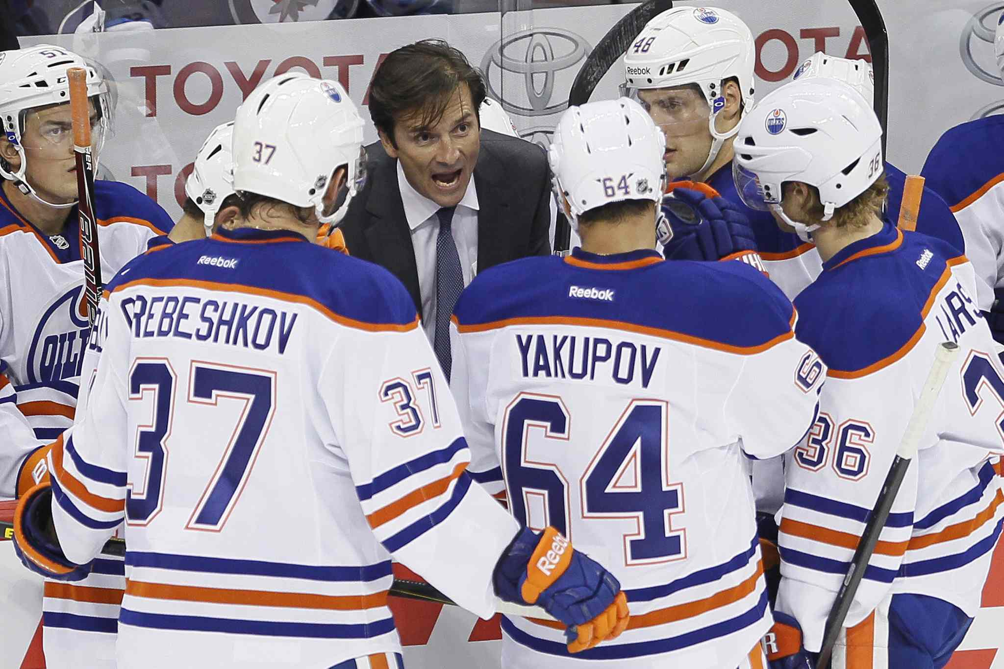 Head coach Dallas Eakins instructs his Oilers during the first period Tuesday evening. He rejects the 'young team' perspective, with the Cup being the goal this season.