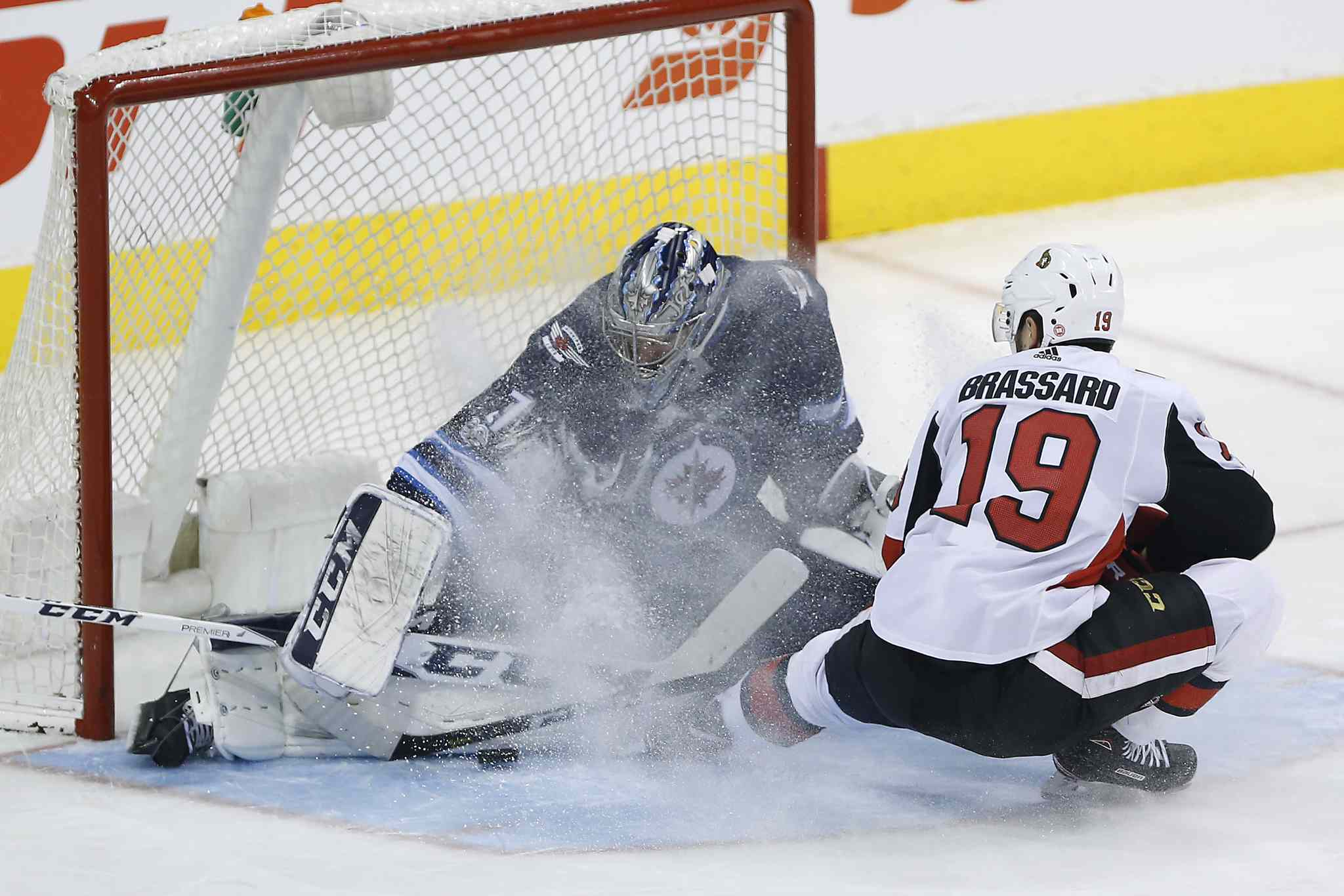 JOHN WOODS / WINNIPEG FREE PRESS</p><p>Winnipeg Jets goaltender Connor Hellebuyck (37) stops the breakaway attempt by Ottawa Senators' Derick Brassard (19) during third period NHL action.</p>