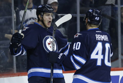 Adam Lowry (left) and Joel Armia signed two-year contract extensions with the Winnipeg Jets Thursday. (John Woods / Winnipeg Free Press files) (WINNIPEG FREE PRESS)
