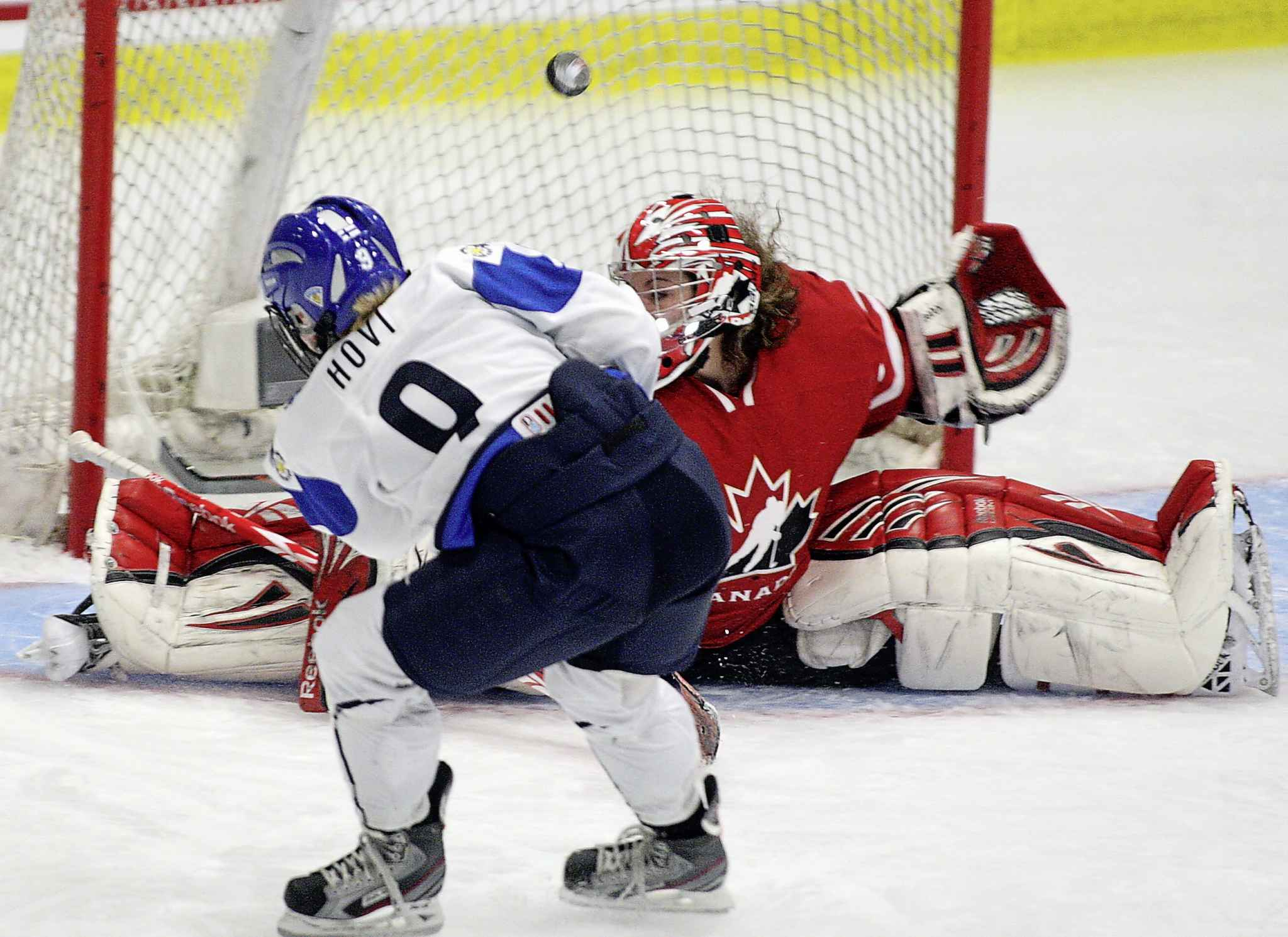 Hovi scores against Team Canada's Shannon Szabados during the World Women's Ice Hockey Championships in 2012.