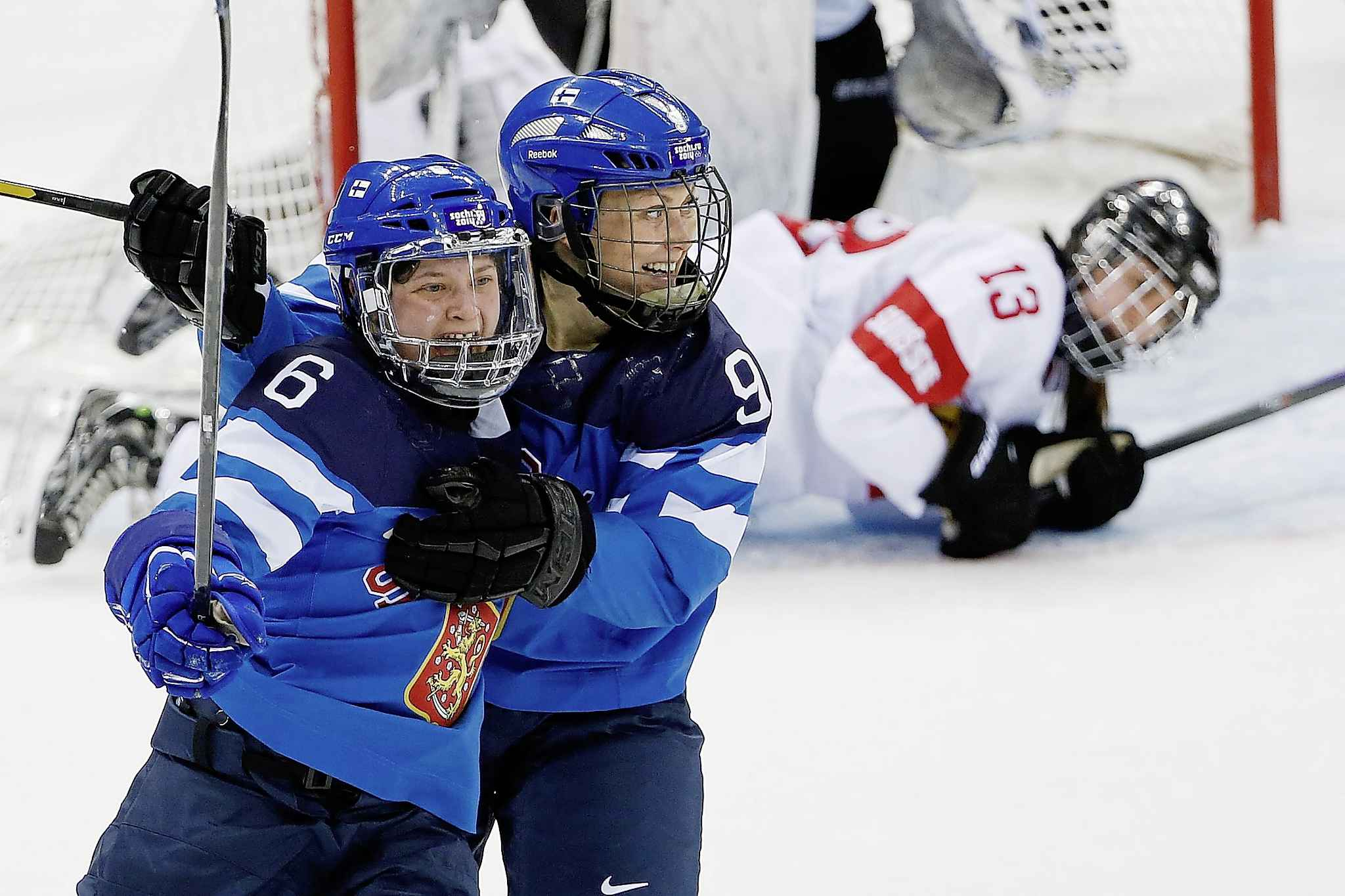 Hovi, right, celebrates a game-winning goal in overtime with teammate Jenni Hiirikoski of Finland during the 2014 Winter Olympics in Sochi, Russia.