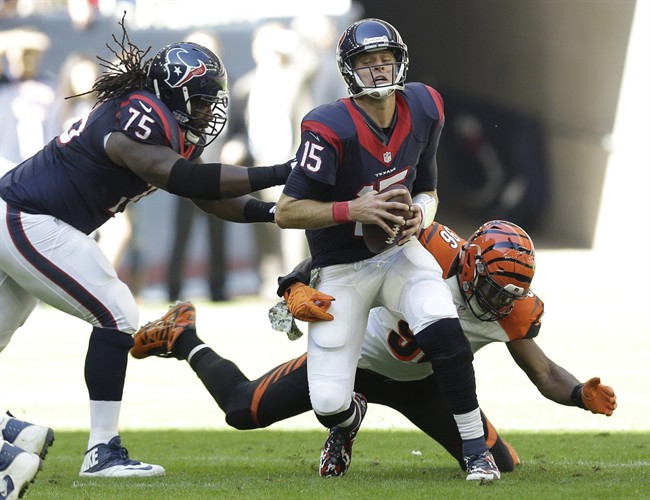 Houston Texans' Ryan Mallett (15) is pressured by Cincinnati Bengals' Carlos Dunlap (96) during the first quarter of an NFL football game, Sunday, Nov. 23, 2014, in Houston. (AP Photo/David J. Phillip)