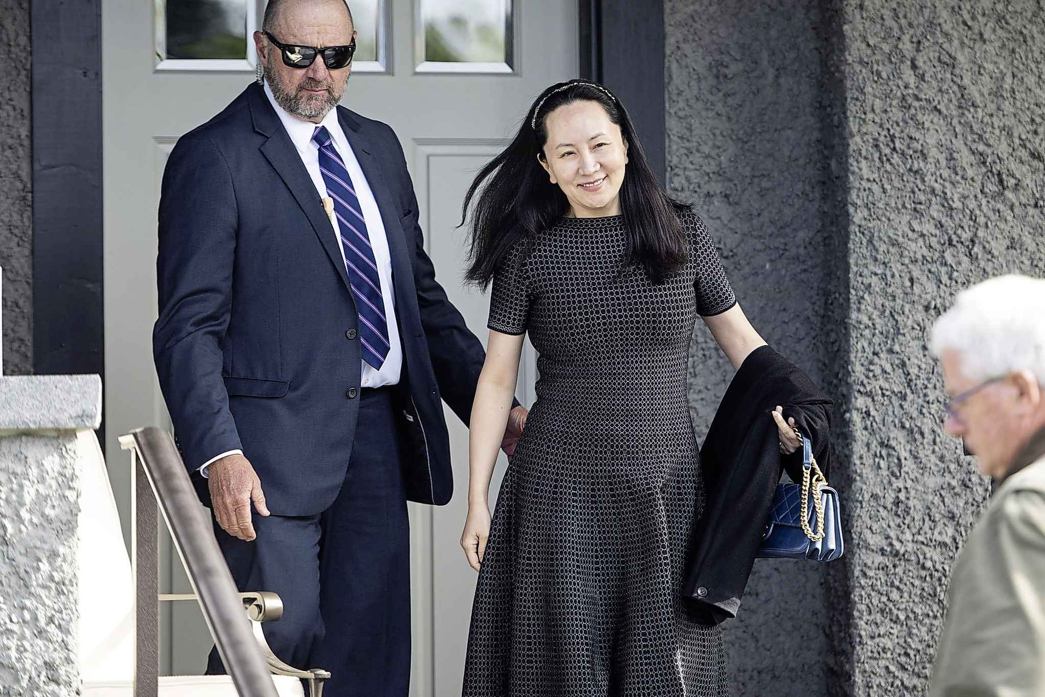 Meng Wanzhou, chief financial officer of Huawei Technologies Co., leaves her house for a hearing at the Supreme Court in Vancouver in May. (Jimmy Jeong / Bloomberg)