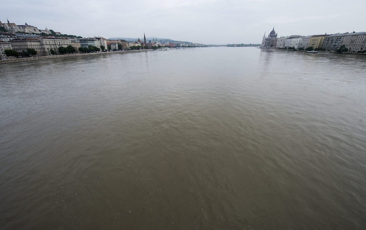 The swollen Danube river is seen from the Chain bridge in Budapest, Hungary. The Parliament building is on the right. (Tibor Illyes / The Associated Press)