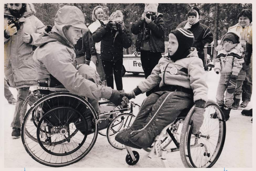 Rick Hansen greets Colin Mathieson, 7, during his mid-day break (about 2 hours long) on the Trans-Canada Highway about thirty miles (49 Kilometres) west of Falcon Lake, MB. Colin Mathieson has since become a top Canadian paralympic athlete. Wayne Glowacki / Winnipeg Free Press Archives January 17, 1987