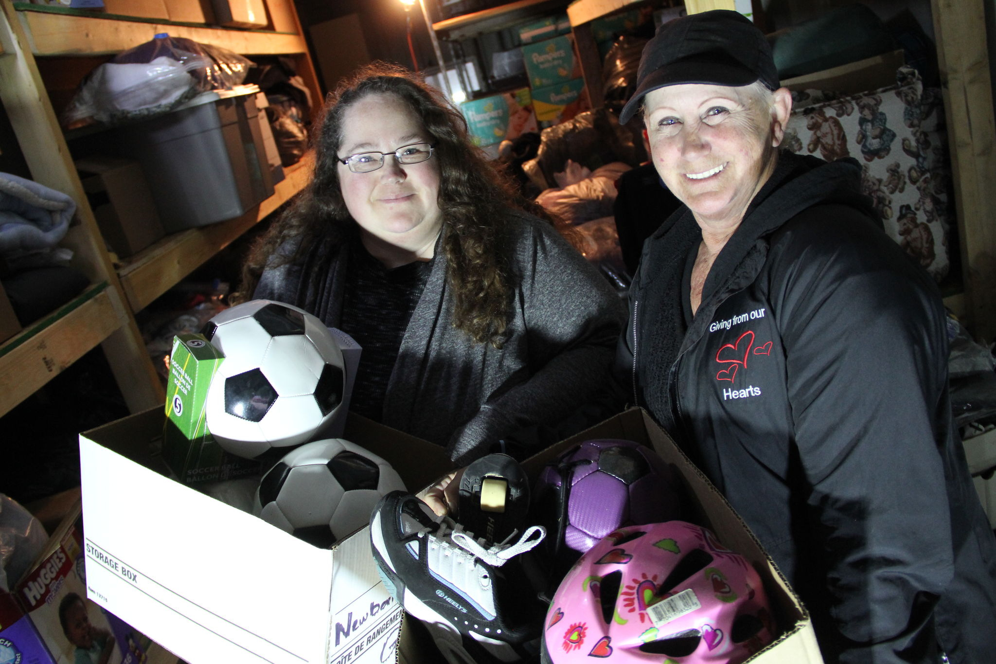 Billie Jo Hunter, left, and Tereina Neubauer, both of New Bothwell, are two of the driving forces behind a massive charity effort that involves shipping whatever is needed to remote northern communities, like sporting equipment. They are holding a dinner and drink fundraiser at Frantz Inn Saturday night.