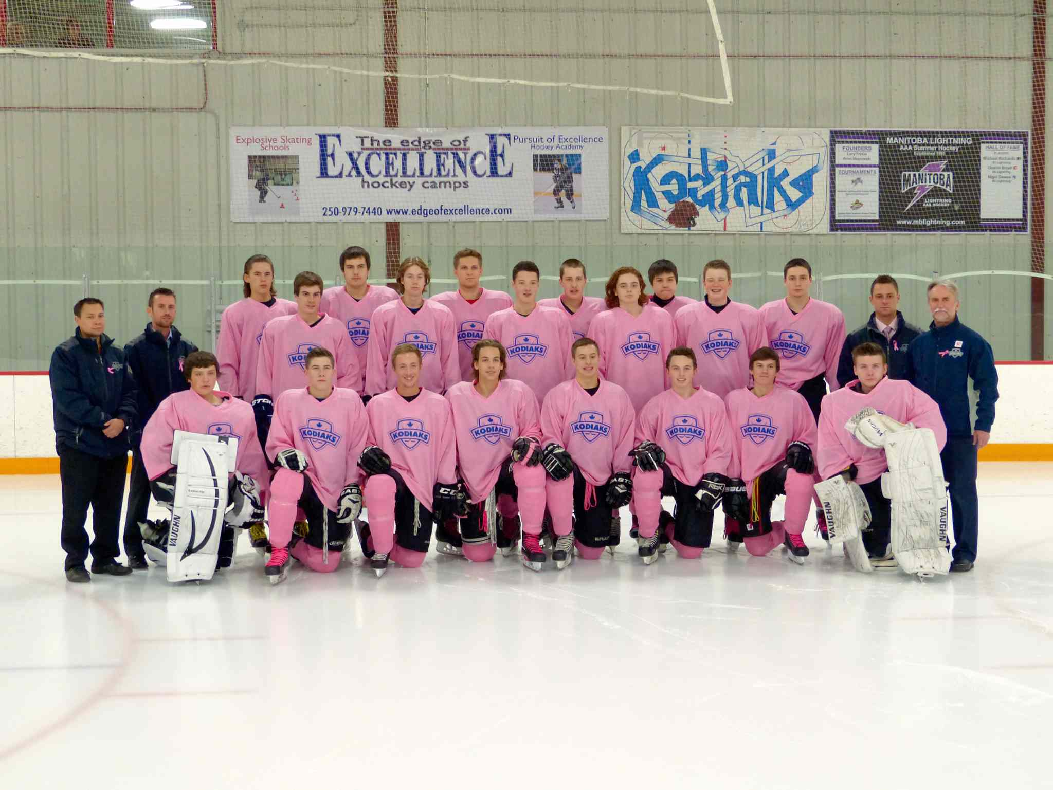 The River East Kodiaks are shown in the pink jerseys they wore during a 4-2 win over the Dakota Lancers at Gateway Recreation Centre on Oct. 29. Back row: Austin Smith, Tristan Beach-Ducharme, Evan Loeb, Dale Mounk, and Chase Beach-Ducharme. Middle row: Darren Wong (assistant coach), Chris Zajac (assistant coach), Josh Martineau, Steven Paulley, Holden Bard, Brady Valiquette, Jackson Dartnell, Jonathan Corbett, Scott Zieba (assistant coach), and Ben Zajac (head coach). Front row: Myles Piche, Craig Caine, Tyler Hall, Nolan Wisniewski, Matt Allen, Mike Dzioba, Easton Brasko, and Randy Quick.