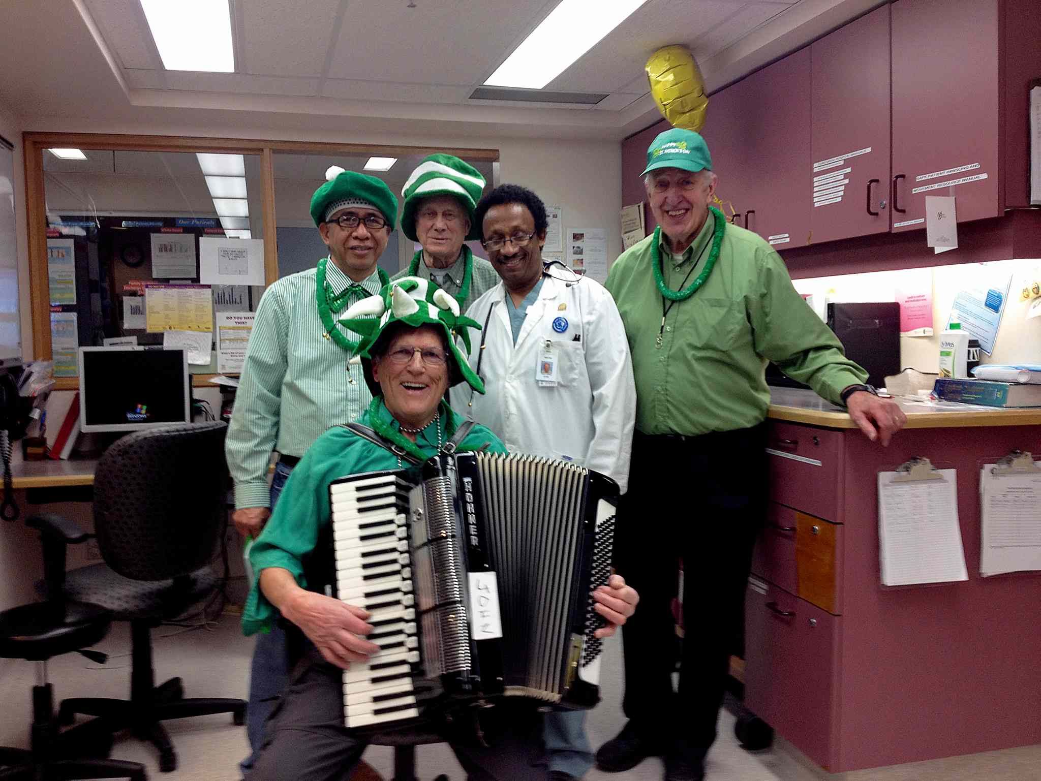 A group of local seniors from Blessed Sacrament Parish brought some St. Patrick's Day joy by playing some music for those at Concordia Hospital on March 15. Clockwise from left, Pedro Gregorio, Mel Belluk, Andrew Ilchena, and John Kessling are shown with a doctor at the hospital.