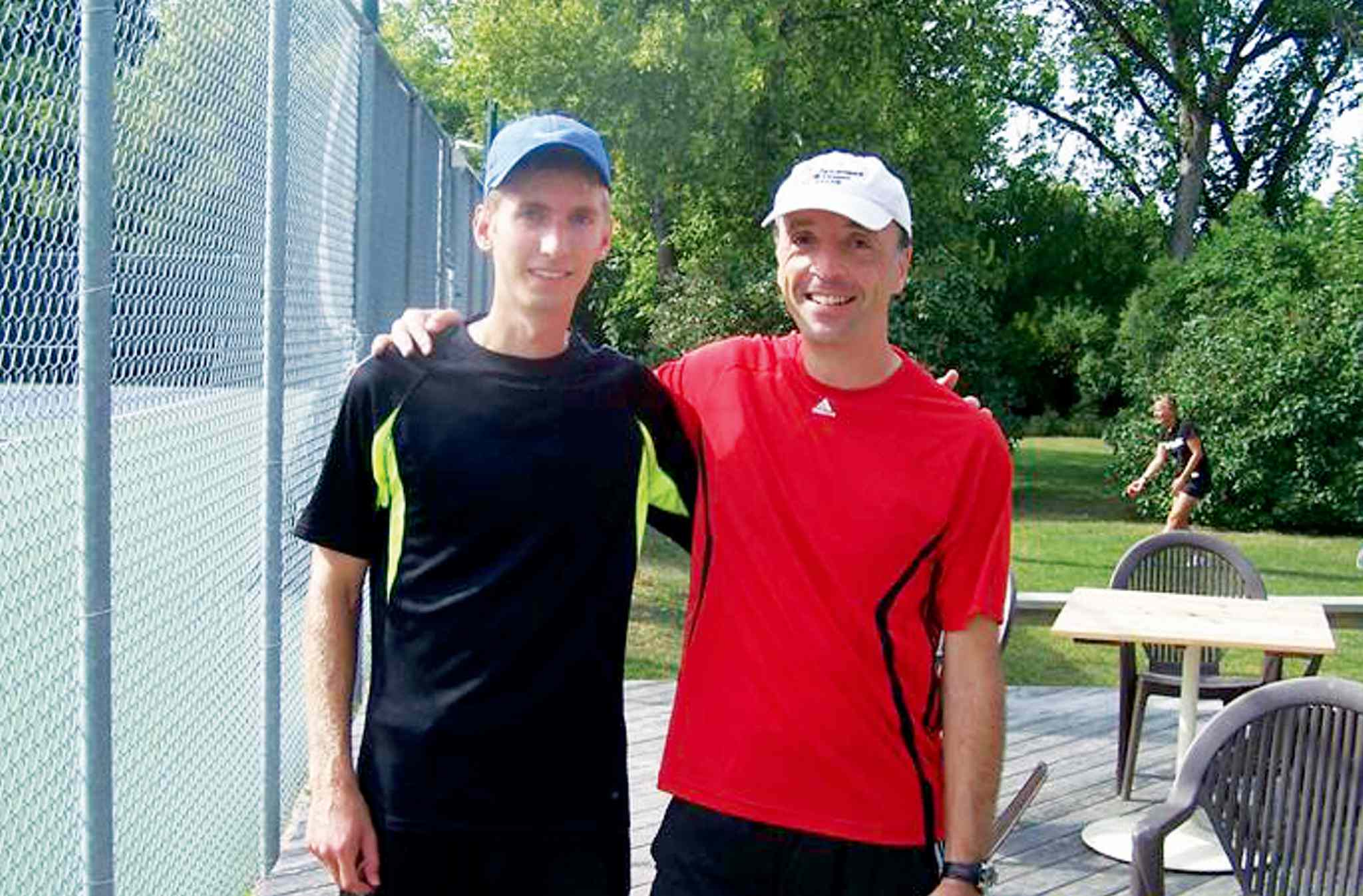 Tennis for Siloam organizer Markus Deutsch (right) is shown with Braeden, one of six players who participated playing against the Harbour View South resident during the eight-hour tennis marathon at Kildonan Tennis Club on Sept. 7. The fundraiser for Siloam Mission raised nearly $4,000 to provide approximately 1300 meals.