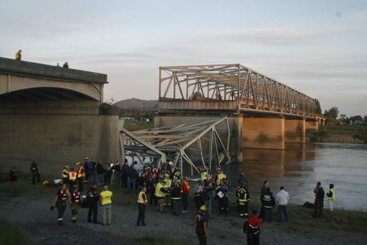 A portion of the Interstate-5 bridge is submerged after it collapsed into the Skagit River. (Joe Nicholson / The Assocated Press)